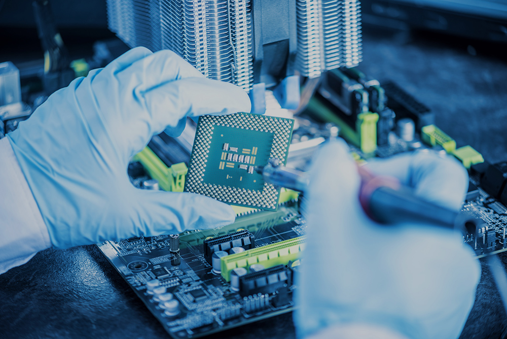 Engineer technician computers in gloves on the hands is reviewing the failure. Concept of repair microchip